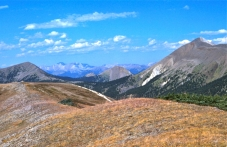 A section of the boundary between Jasper National Park and Willmore Wilderness Park (in the far background) follows along the ridgeline between the mid-ground peak (left) and the highest peak (right). This is typical terrain wardens patrol during the provincial hunting season.