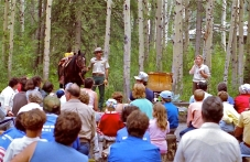 Park Interpreter Adrienne Mason introduces my riding horse, Anita, and me to the audience at a campfire presentation at Pocahontas Campground before my talk about the role of a park warden.