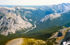 The Fiddle River Valley meanders below the frontal ranges of the Rockies in Jasper. The foothills of west-central Alberta lie beyond the Jasper National Park boundary that traverses across Table Mountain (distant left) and Slide Mountain (distant right).